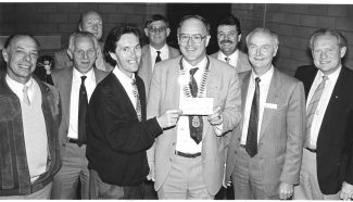 June 1990. Head of centre, Rick Oliver, receives a cheque for the Wickford Youth Club and Community Centre, Irvon Hill.