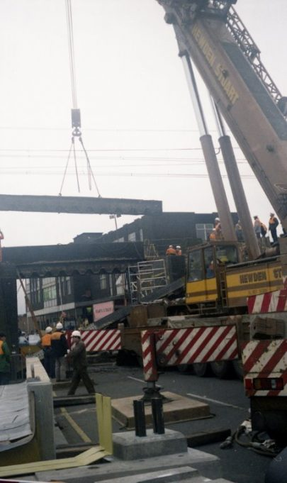 Work continues, removal of the beam that damaged the cab must wait until later | John Fuller