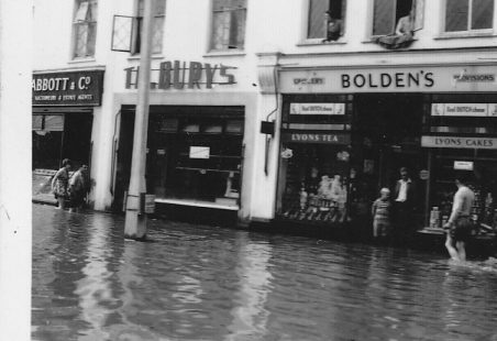 News of the flood of 1958 goes out to the nation.