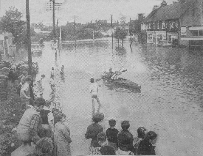 Wickford was the worst-hit town, and this was the scene in the Southend Road on Saturday morning. The River Crouch had burst its banks and inundated most of the shopping area.