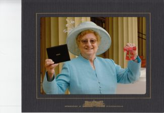 Audrey's official Photo with her MBE