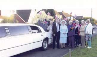 The neighbours crowd round to watch Audrey well on this special day