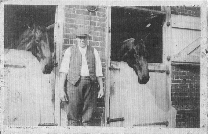 George Key standing outside the stables of ? Runwell Hall