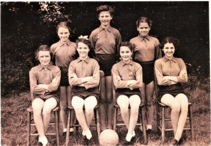 This photograph is of the netball team in the late 1940s. From the left: the back row are Christine Hillyer, Isobel Thompson and Eileen Perry; the front row are Josie Cootes, Pauline Hawkins, Grace Stone and Gillian Squirrell. (Names provided by Pauline Hawkins Wheat).
