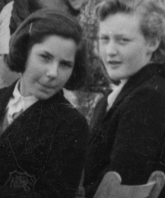 Two girls.  Note school badge | John Fuller