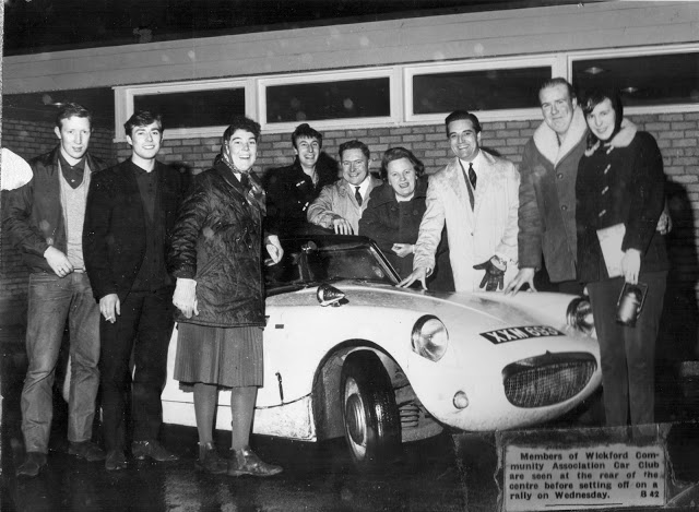 Joyce (in front of the driver's door) and friends at the car club
