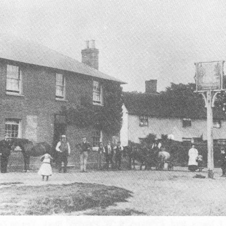 Edward Cox is standing outside his pub c 1890.
