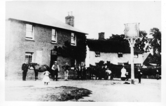 The White Swan c.1886. The proprietor Mr Edward Cox standing outside the door