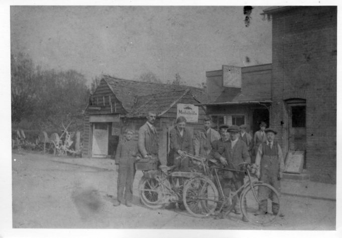 Outside Darbys Factory.c1918 The small boy on the left is Mr Bill Lepper.The man holding the motorcycle handle is Mr Stan Nicholls one time Essex and England Cricketer
