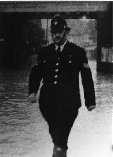 Sgt Adams on patrol during a Wickford flood.