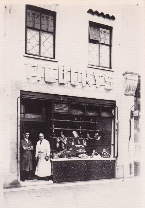 Tilburys Butchers during the war. The shop window had been blown out, possibly twice, so shutters were used until after the war. | Corin Yeo