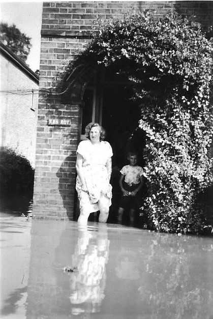 John's mother by the front door of their house. | John Potton.