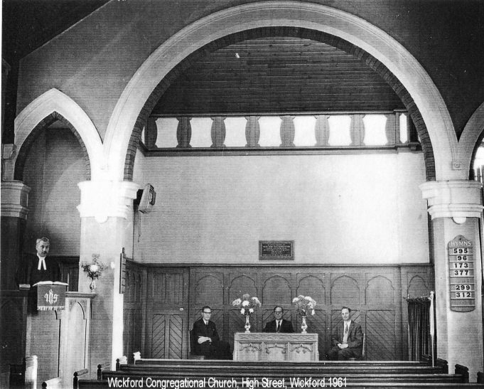 This 1961 photograph shows the inside of the Congregational Church which stood on the High Street until it was demolished to make way for commercial buildings. The preacher was the Reverend Stanley Hodges, and sitting on the left was Laurie Lay.