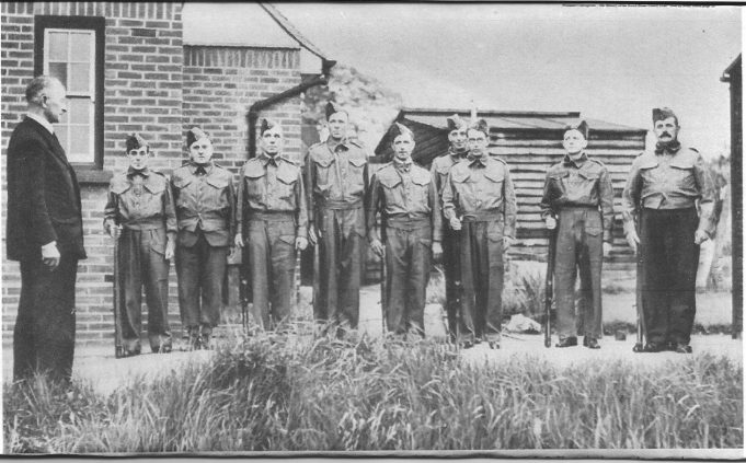 Colonel Burton,the 'father' of the 1st Essex Battalion Home Guard, with the first L.D.V. patrol ever to operate.