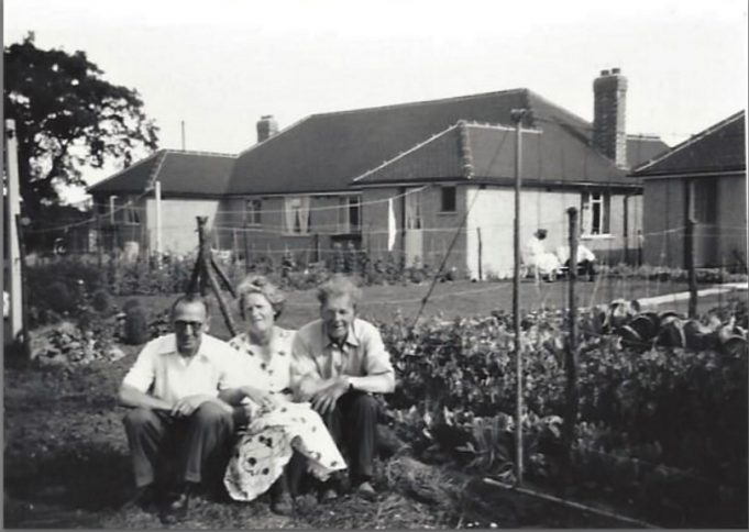 Back Garden of 28 Azalea Avenue taken about 1959 By now the bungalows and gardens in Laurel Avenue were built and established. They backed on to the side of my Grandparent's property. You will see the trees are still there on the opposite corner of the road. At the bottom of my Grandparent's garden was space for a garage, which Grandad built. Access was from an unmade lane along the backs of the gardens on that side of Azalea Avenue.