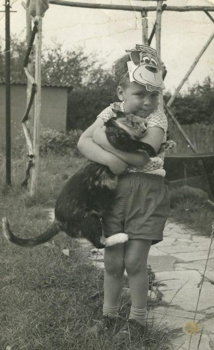 Nicholas White with Moggo, the cat.