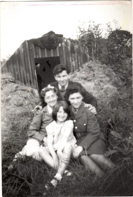 Ramsden View Road c.1943 before the doodlebugs were dropped. Air raid shelter in the background. Brother in the background, his wife on right hand side, she was in the ATS. Irene on the left married to Frederick Phillips who served in the Navy and won DSM Doris Phillips in the front