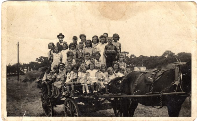 Sunday School outing from Downham Church to Downham Farm. Doris Phillips was third from the left at the back. She was in charge of the group, to make sure nobody fell off.