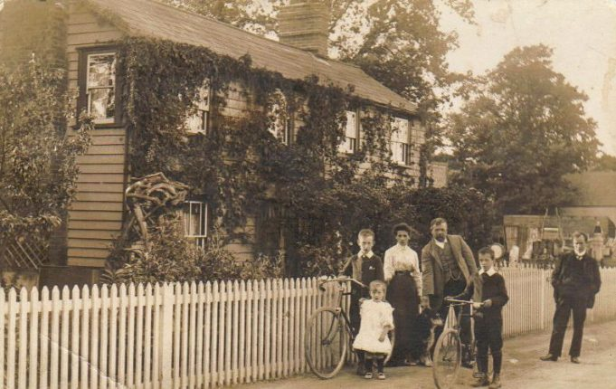 Victoria Villas: Ada Bewers standing behind Solomon.  In front of him is Silva.  John is holding the bicycle and Frank Carter is stroking the dog.